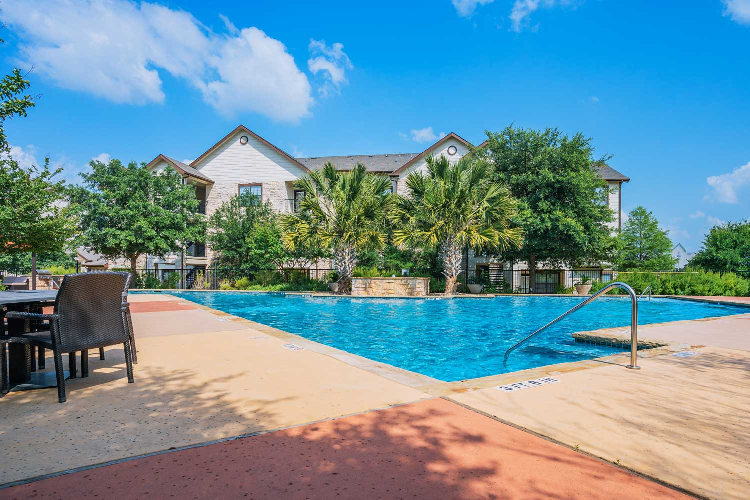 Resort-Style Swimming Pool w/ Cabanas at Oxford at Tech Ridge Apartments in Austin, TX