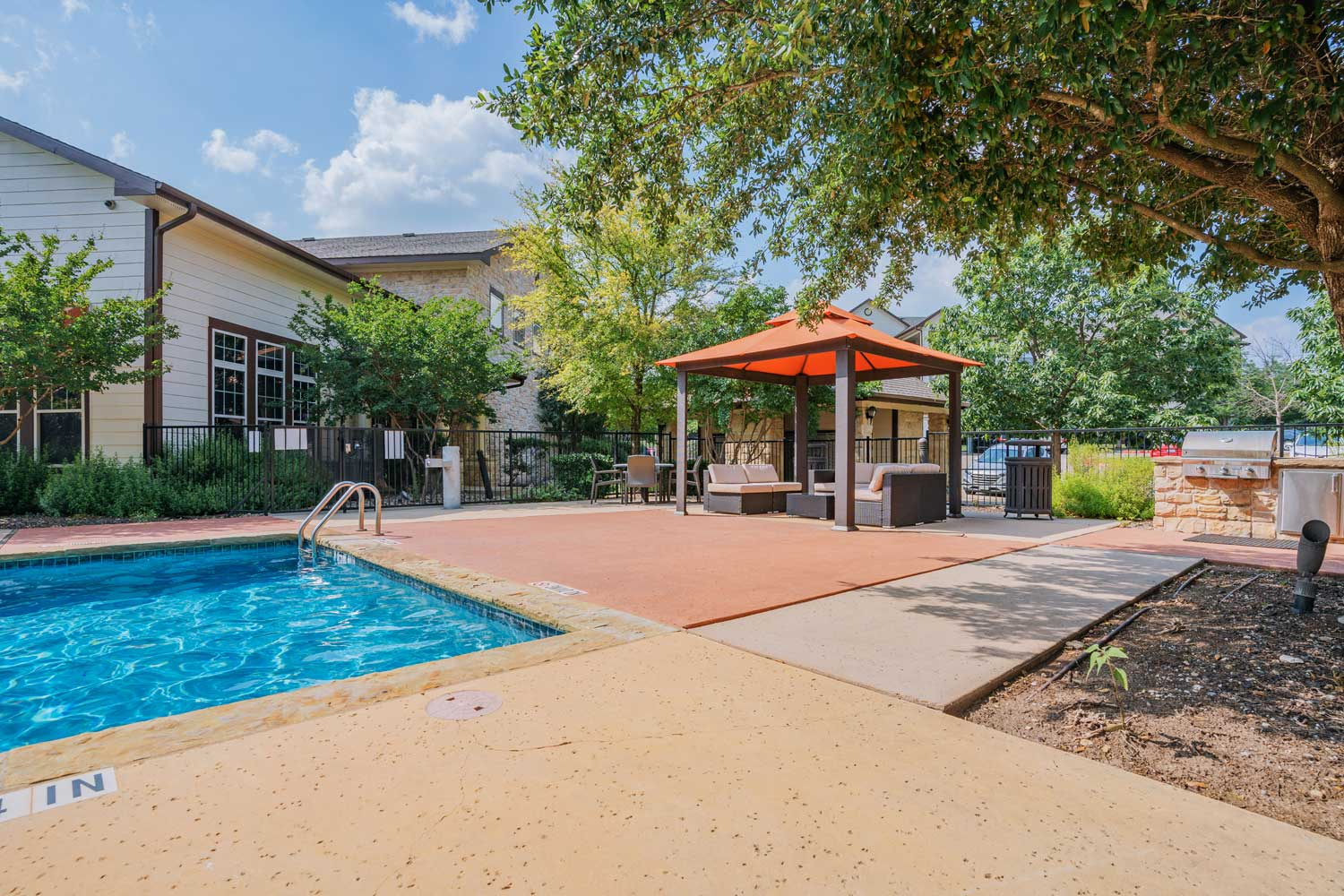 Swimming Pool w/ Cabanas at Oxford at Tech Ridge Apartments in Austin, TX