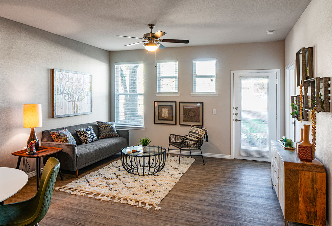 Living Room with Ceiling Fan at The Abali Apartments in Austin, Texas
