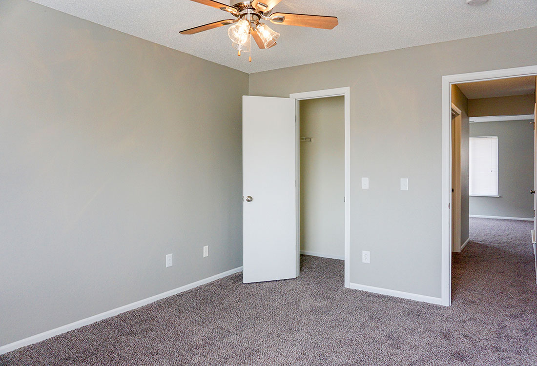 Bedroom with Walk-In Closet at The Bluffs Apartments in Council Bluffs, IA