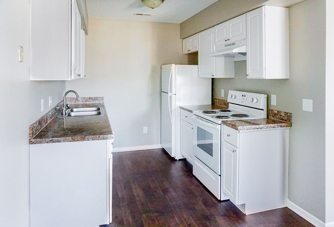 Updated Kitchens with White Cabinets & Appliances at The Bluffs Apartments in Council Bluffs, IA