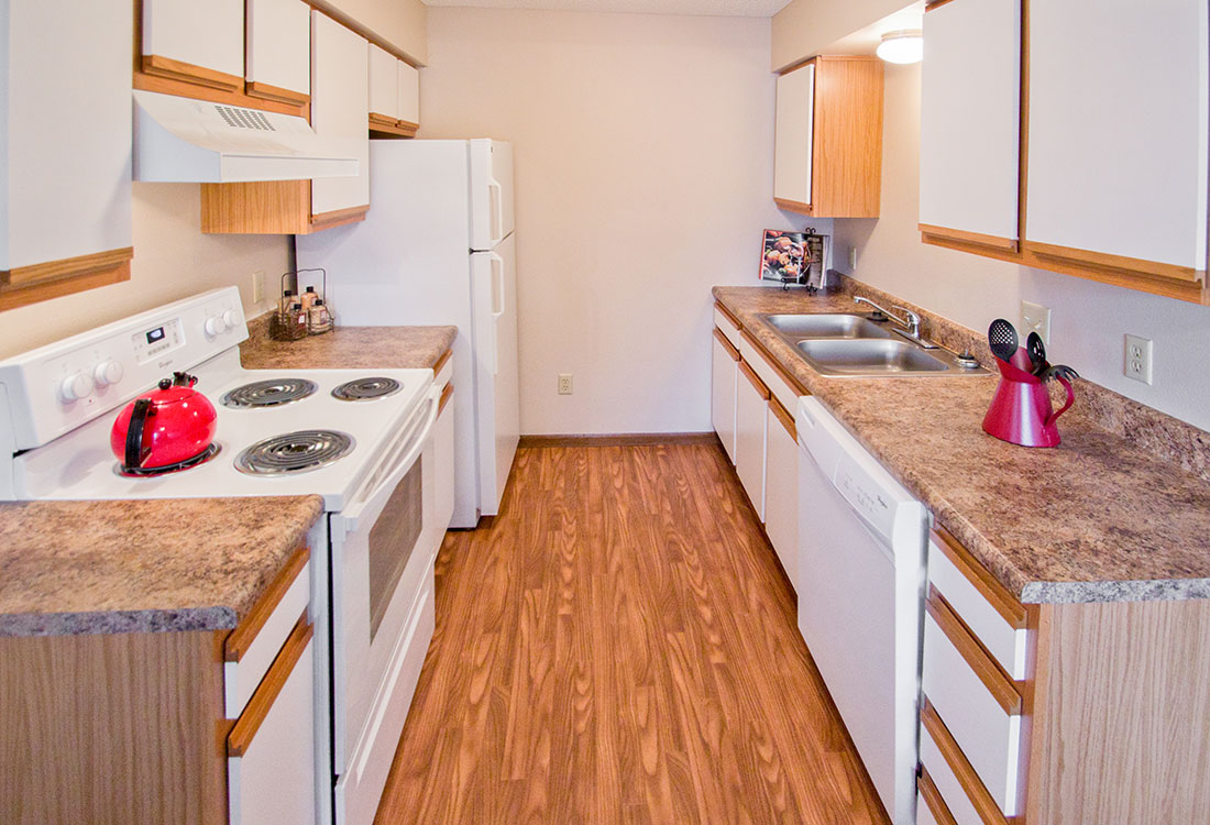 Spacious Galley Kitchen at The Bluffs Apartments in Council Bluffs, IA
