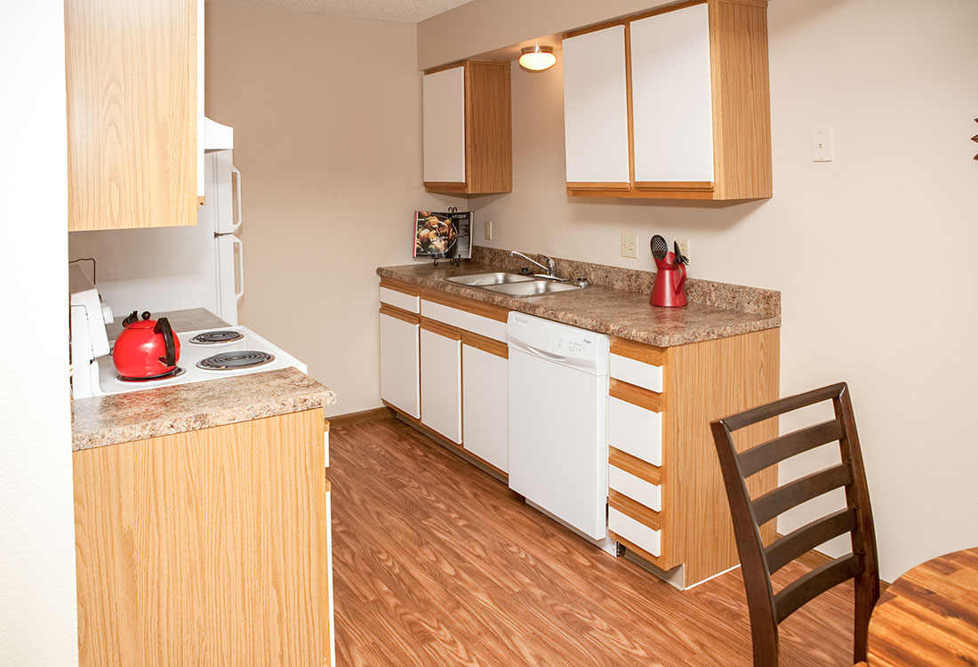 Modern Kitchen Interior at The Bluffs Apartments in Council Bluffs, IA
