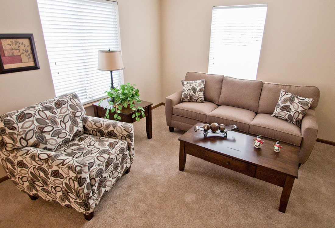 Spacious Living Room at The Bluffs Apartments in Council Bluffs, IA