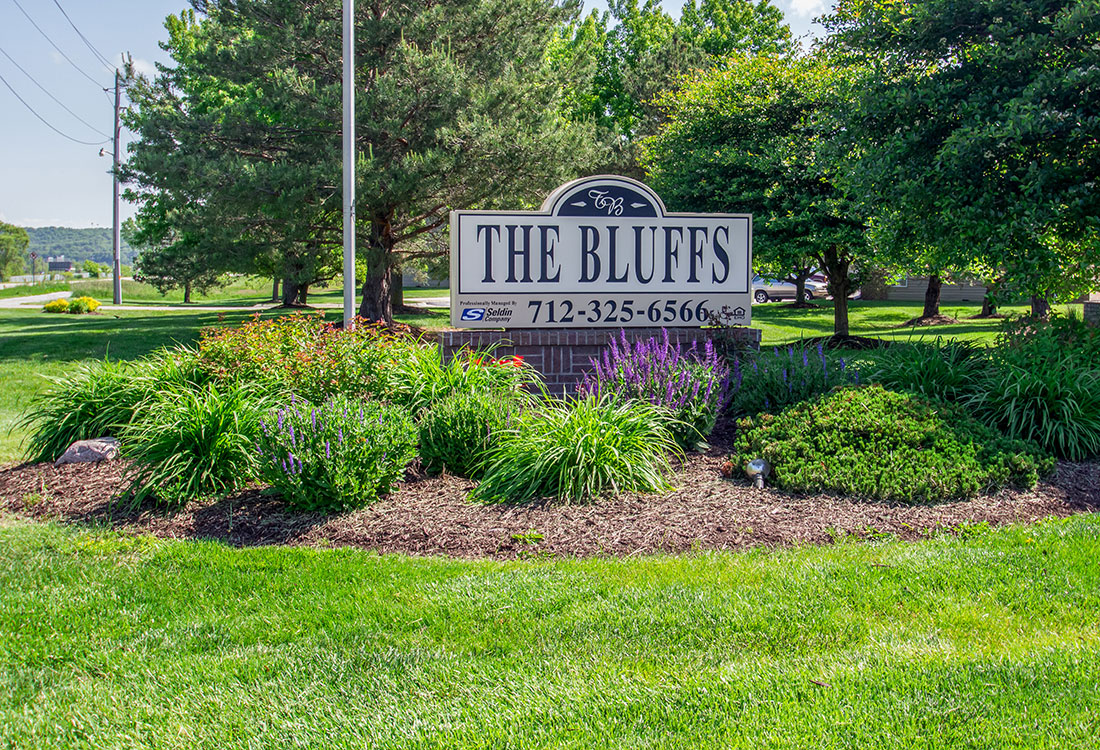 Property Sign at The Bluffs Apartments in Council Bluffs, IA