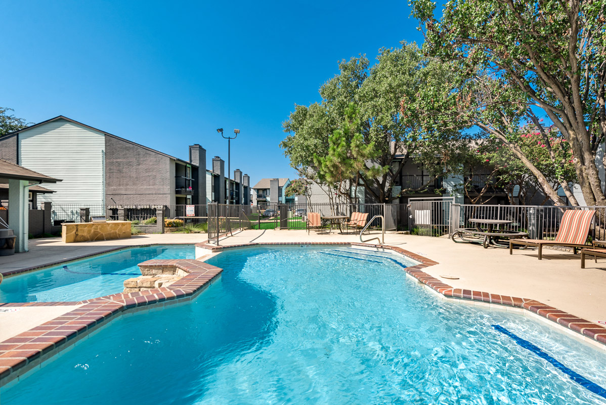 Resort-style pool at The Harrison Apartments in Dallas, TX