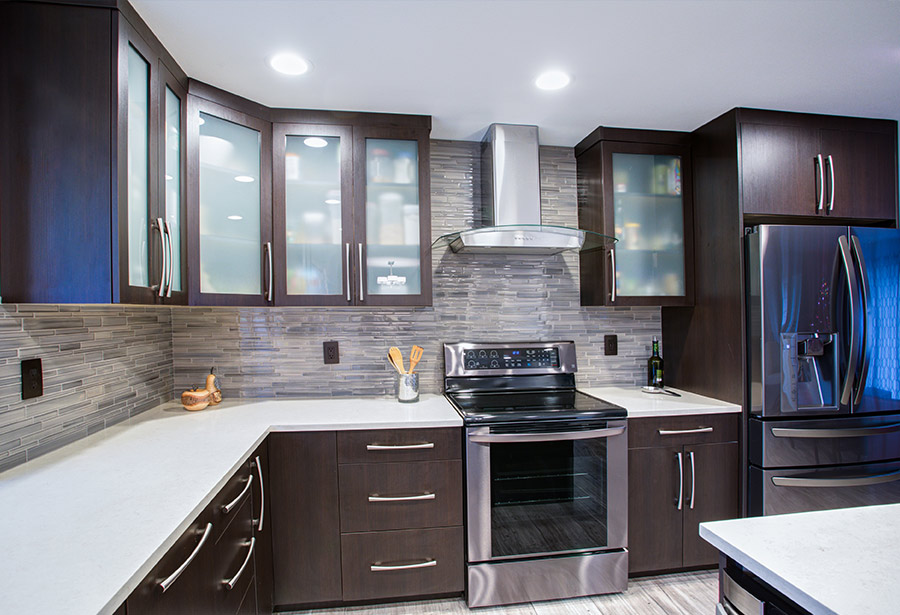 Kitchen with Stainless Steel Appliances at The Skyrise Apartments in New Orleans, LA