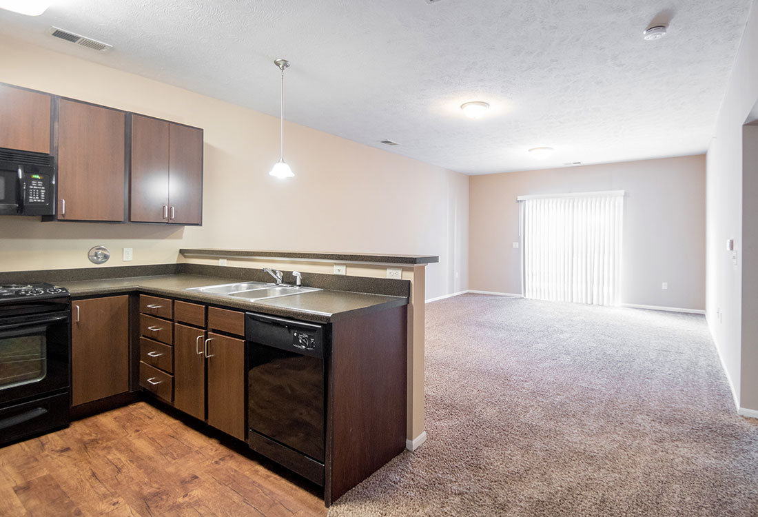 Kitchen & Living Room at The Oaks at Lakeview Apartments in Ralston, NE