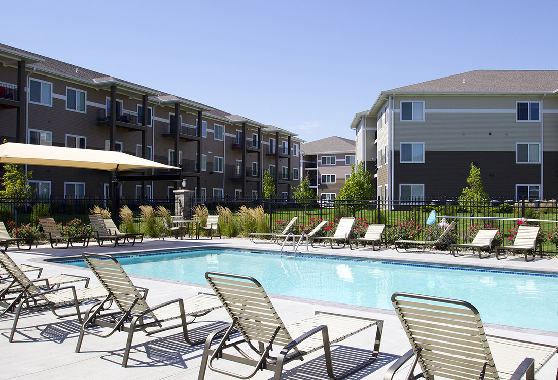 Pool Lounge Area at The Oaks at Lakeview Apartments in Ralston, NE