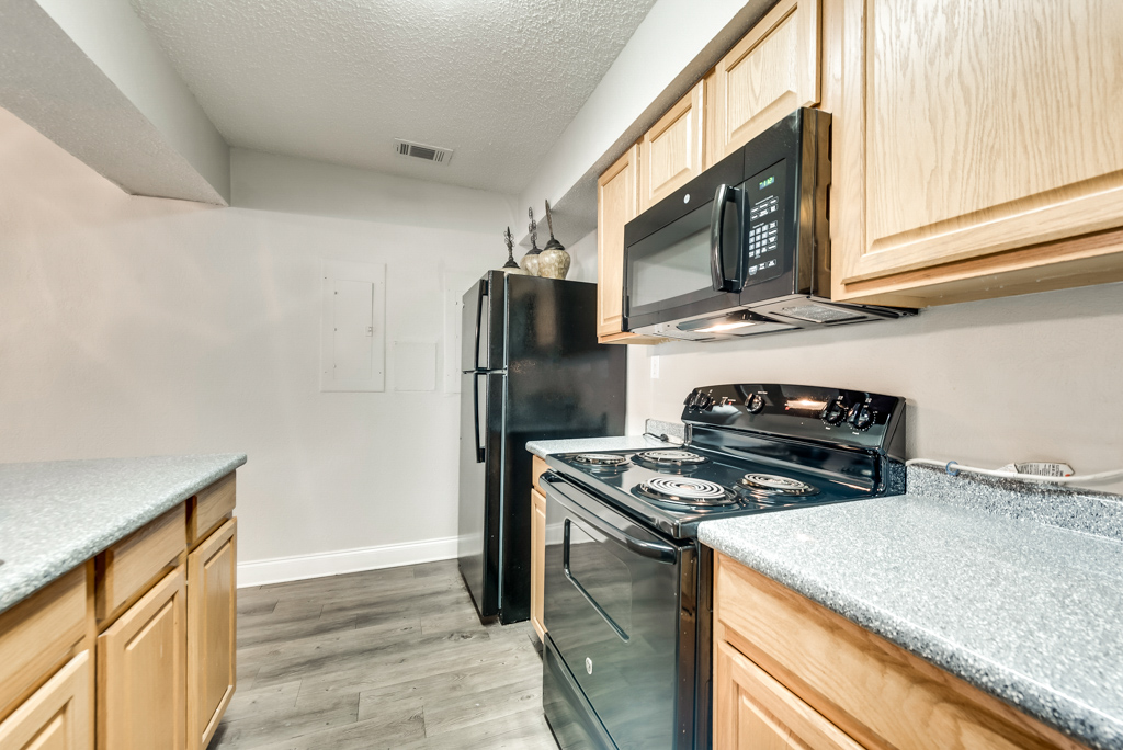 Black Kitchen Appliances at The Watermark Apartments in Mesquite, TX