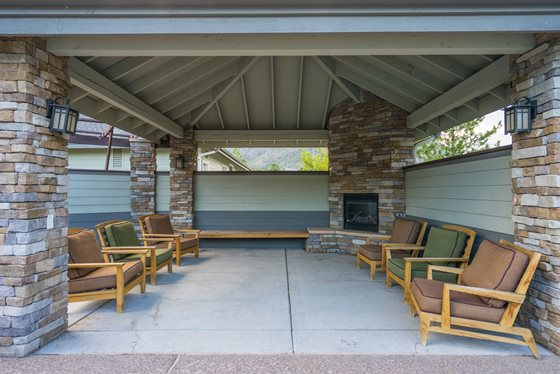 Outdoor Lounge with Fireplace at Timberline Place Apartments in Flagstaff, Arizona