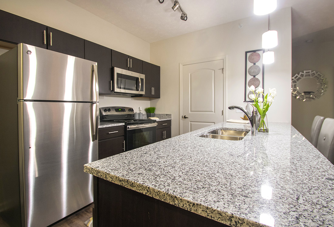 Roomy Kitchen Island at Titan Springs Apartments in Papillion, Nebraska