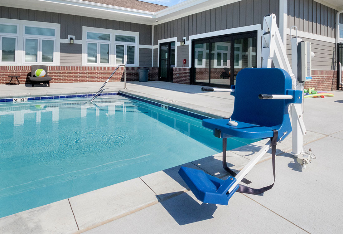 Swimming Pool with Lift Chair at Titan Springs Apartments in Papillion, Nebraska