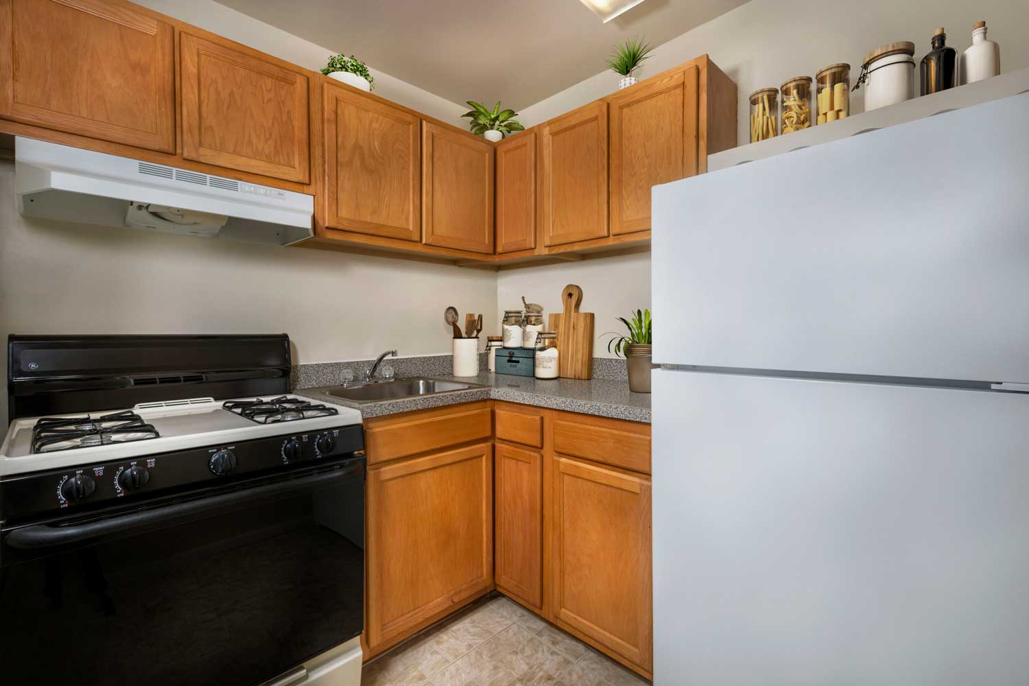 Kitchen with gas range at Top of the Hill Apartments in Temple Hills, MD