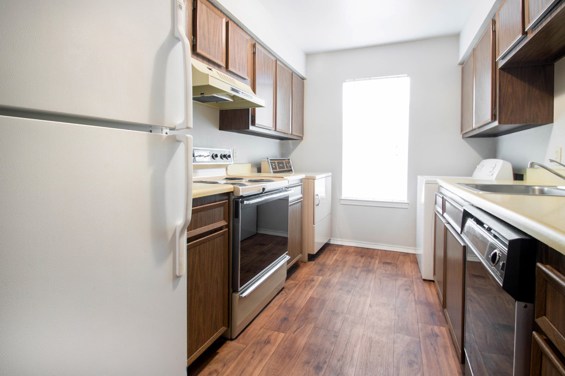 Kitchen with Wood-Look Flooring at The Trace at North Major Apartments in Beaumont, Texas