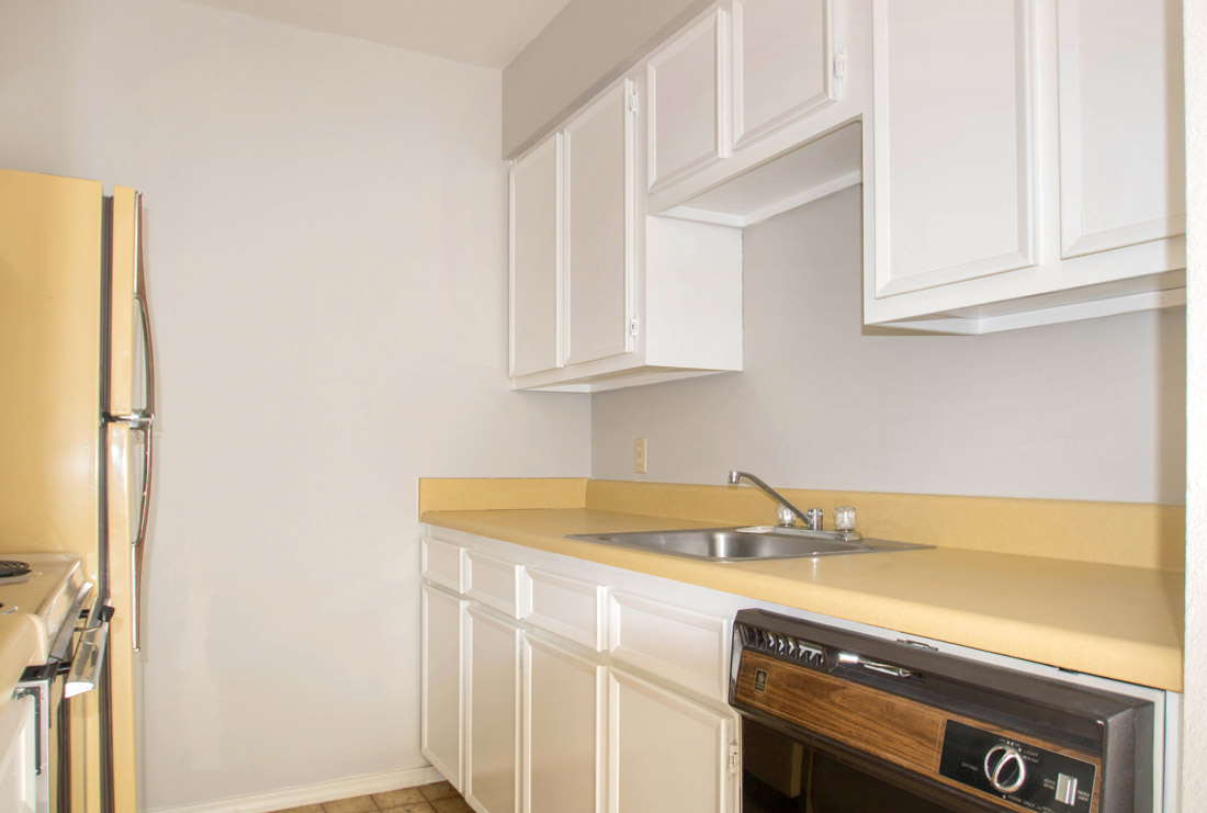 Kitchens with White Cabinetry at The Trace at North Major Apartments in Beaumont, Texas