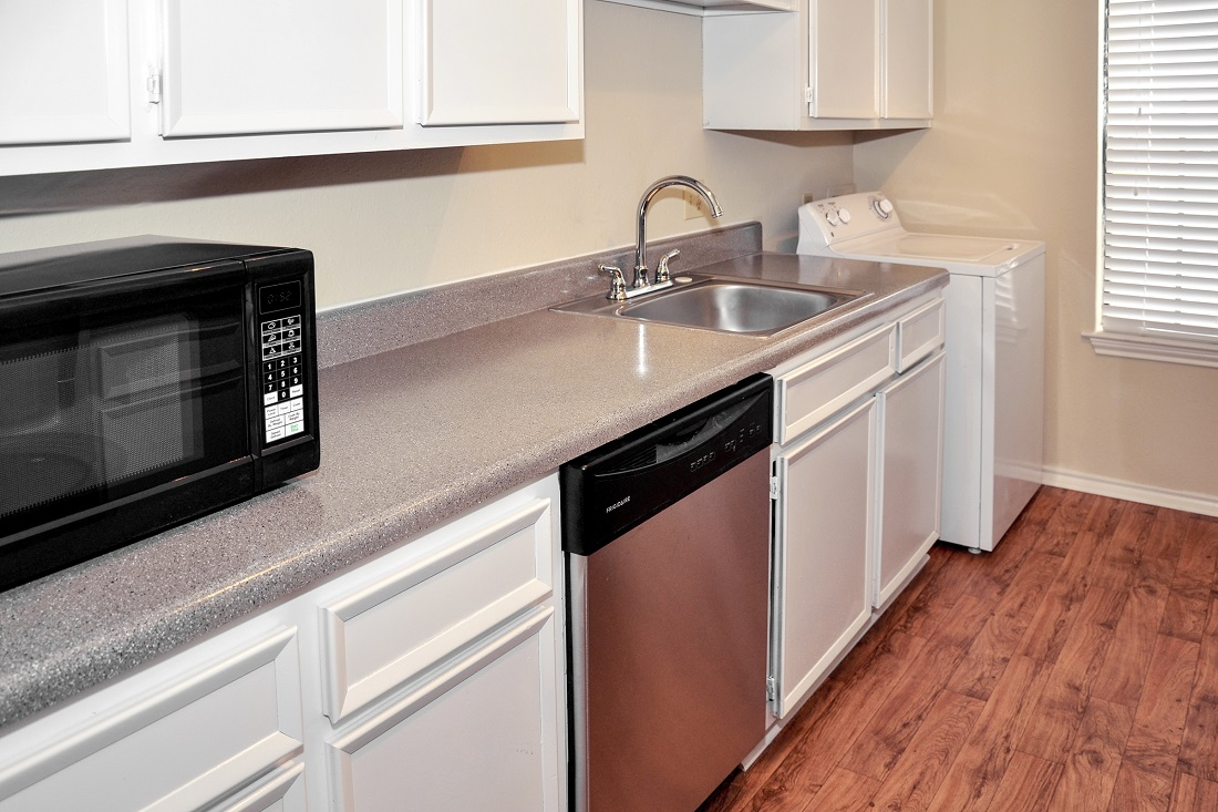 Stainless Steel Appliances at The Trace at North Major Apartments in Beaumont, Texas