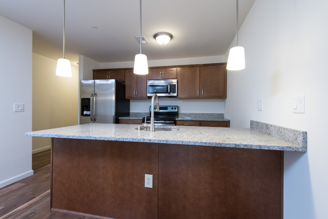 Stylish Salt & Pepper Granite Countertops at U City Flats Apartments in Philadelphia, Pennsylvania