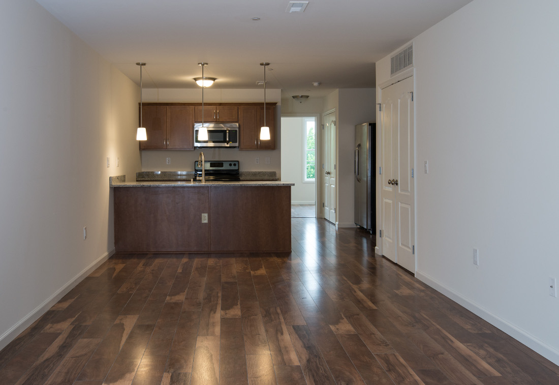 100% Walnut Plank Flooring Interior at U City Flats Apartments in Philadelphia, Pennsylvania
