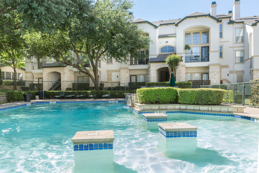 Sparkling Pool at the Vail Village Club Apartments in Dallas, TX