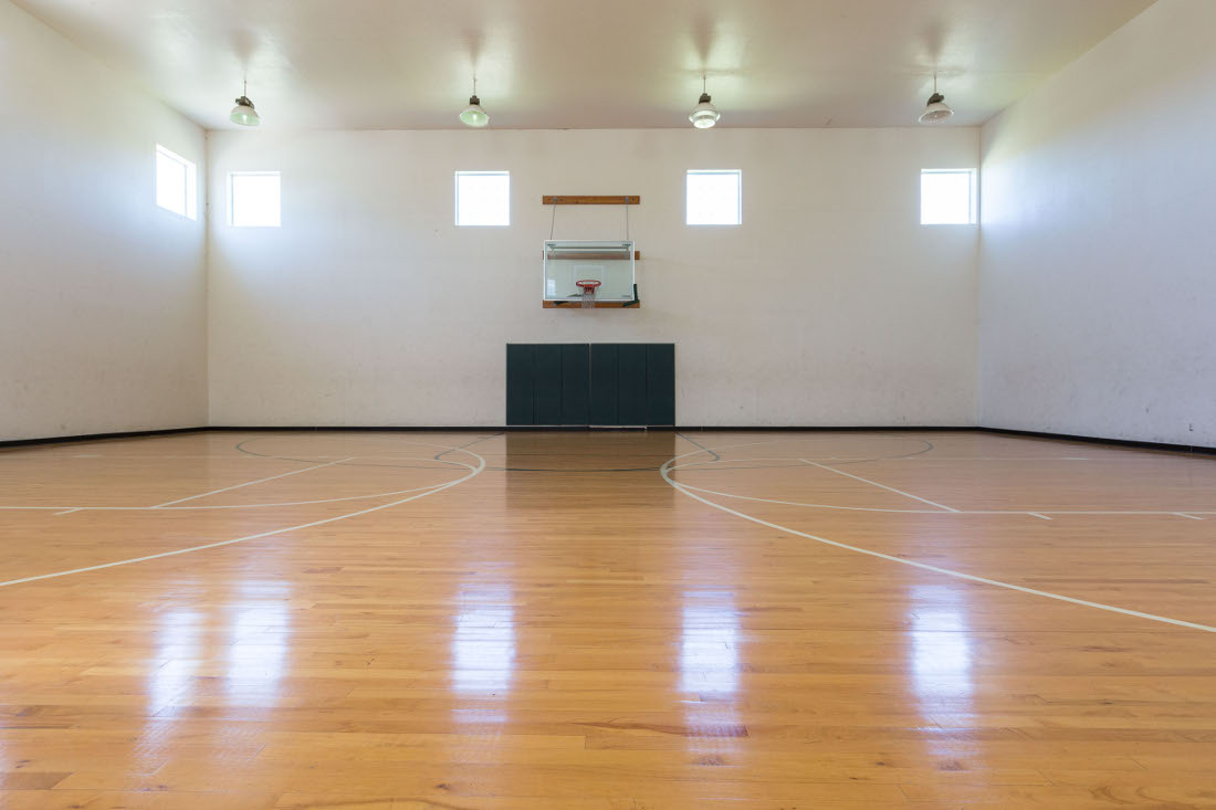 Indoor Basketball Court at the Vail Village Club Apartments in Dallas, TX
