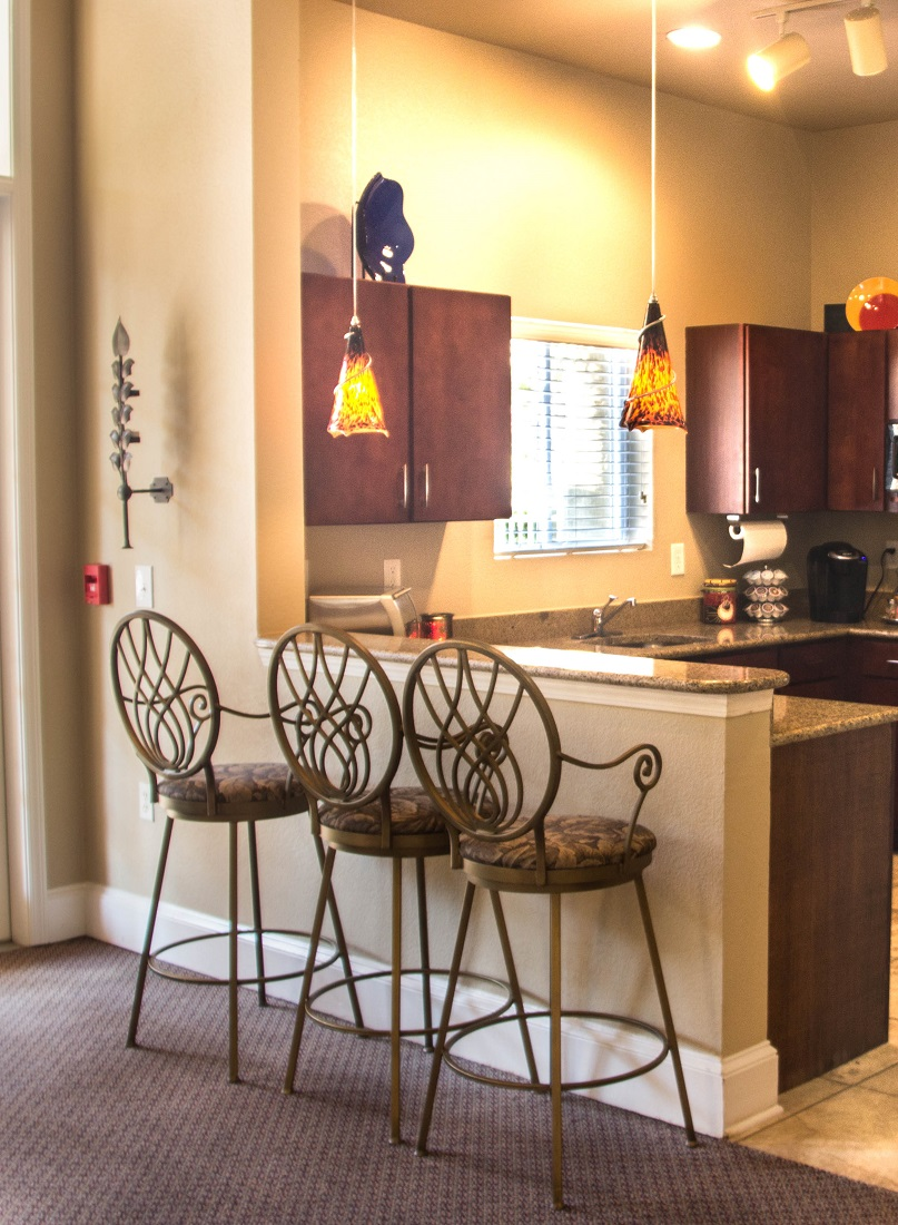 Eat-In Kitchen with Breakfast Bar at Village at Southern Oaks Apartments in Pensacola, FL