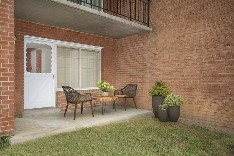 Relaxing patio at Village Square Apartments in Wheaton, MD