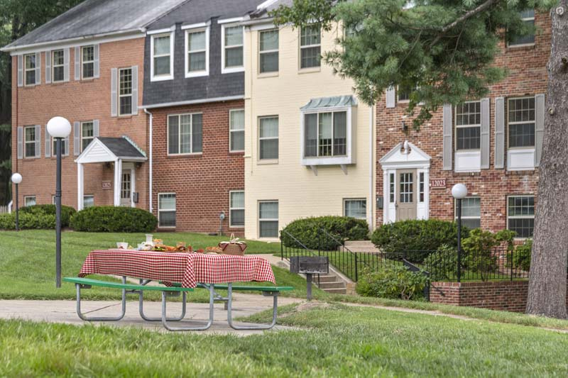 Picnic area with grills at Village Square Apartments in Wheaton, MD