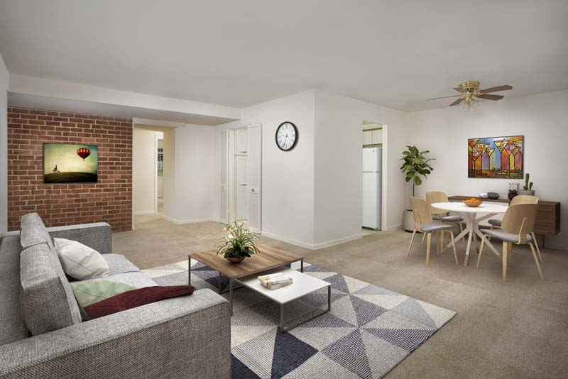 Spacious living and dining area at Village Square Apartments in Wheaton, MD