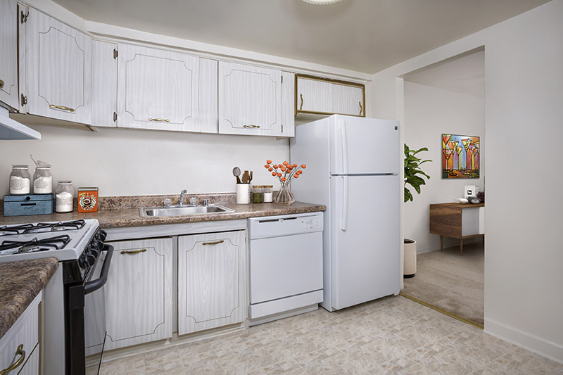 Spacious fully-equipped kitchen at Village Square Apartments in Wheaton, MD