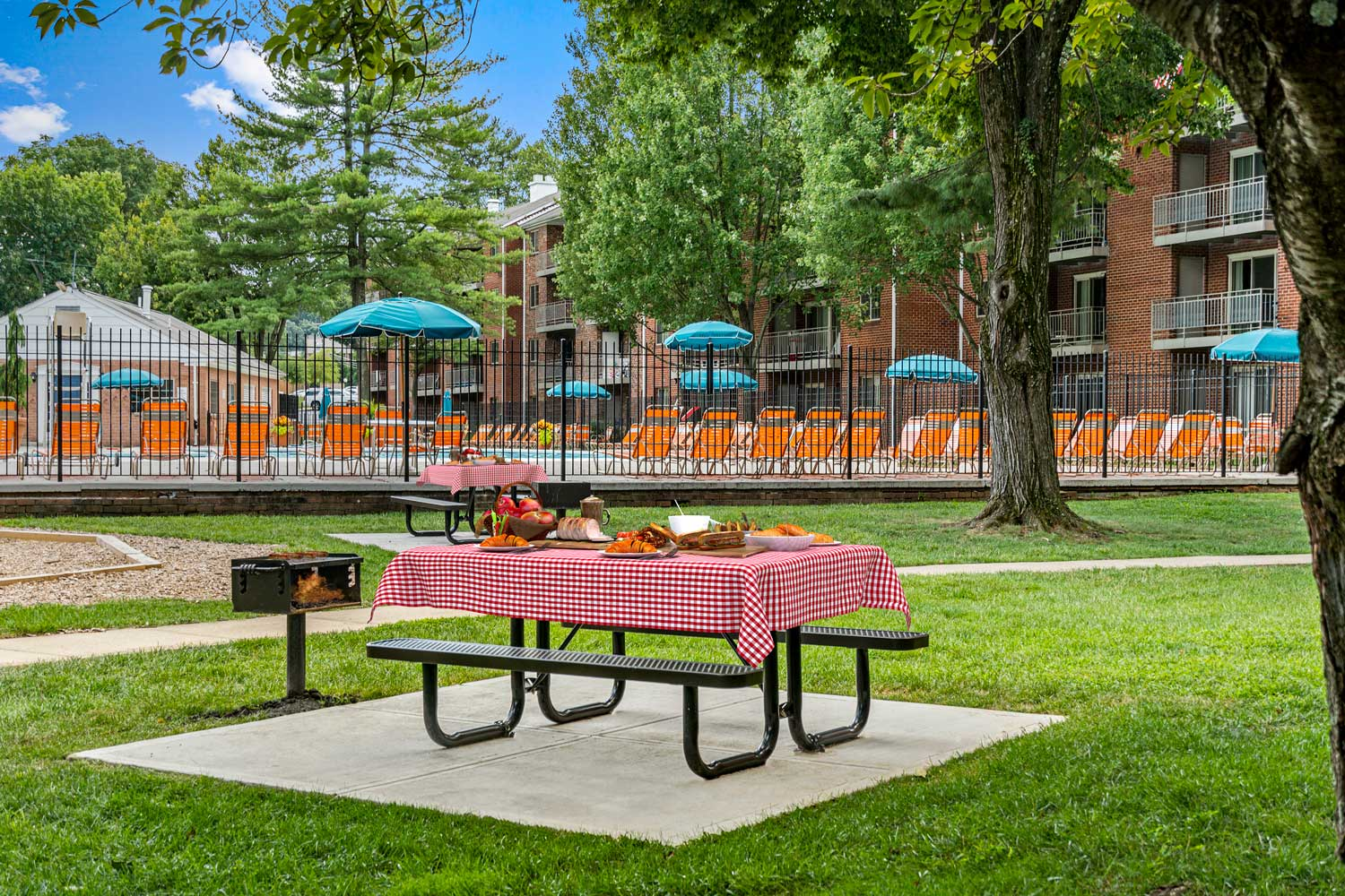Picnic area with grills at Village Square West Apartments in North Bethesda, MD