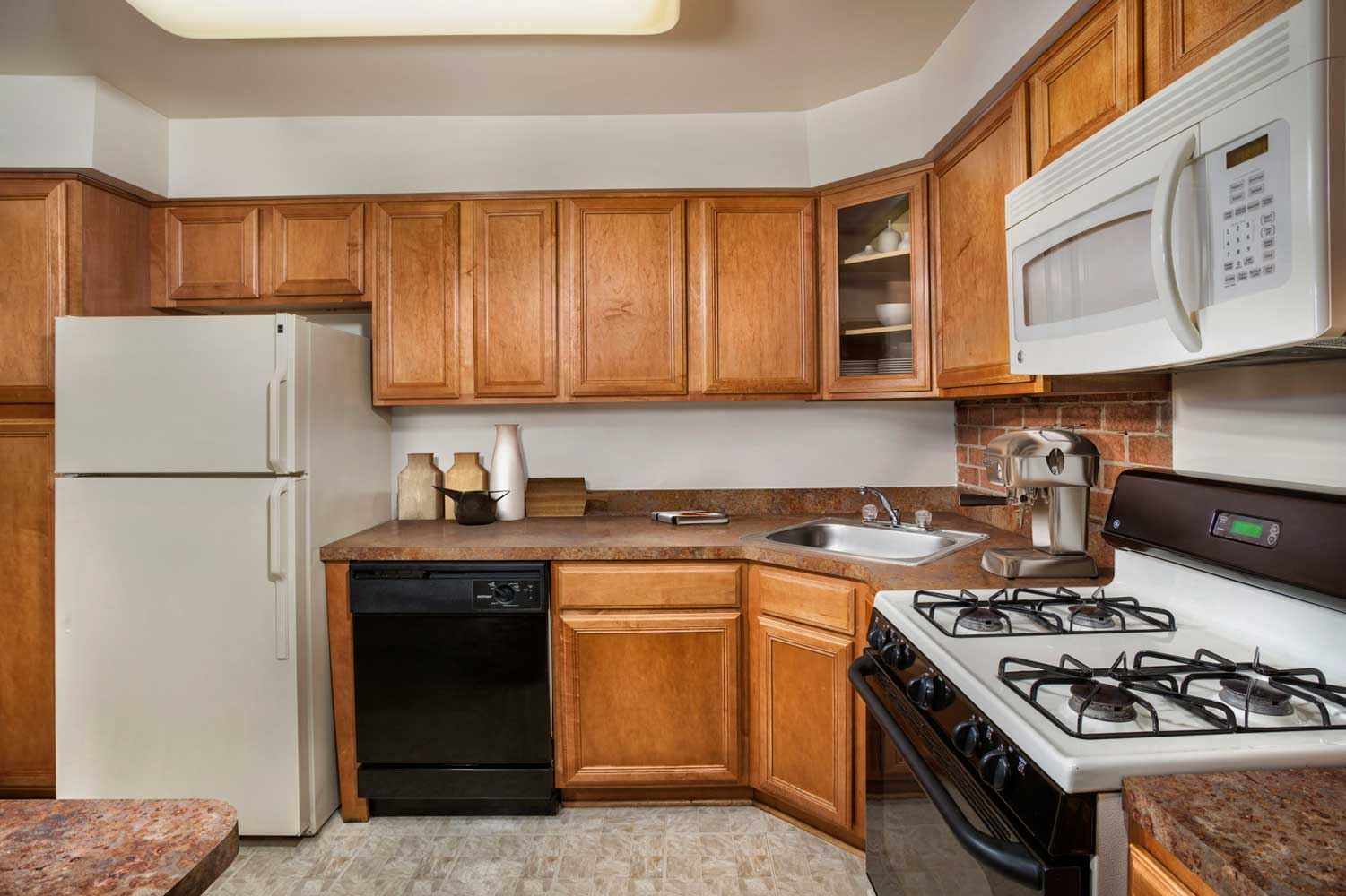 Fully-equipped kitchen at Village Square West Apartments in North Bethesda, MD