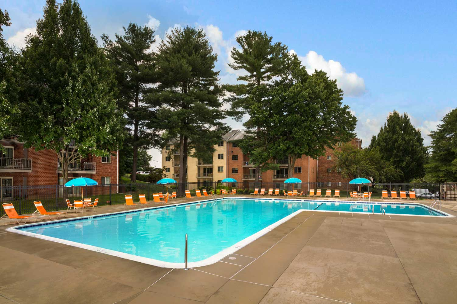Refreshing swimming pool with sundeck at Village Square West Apartments