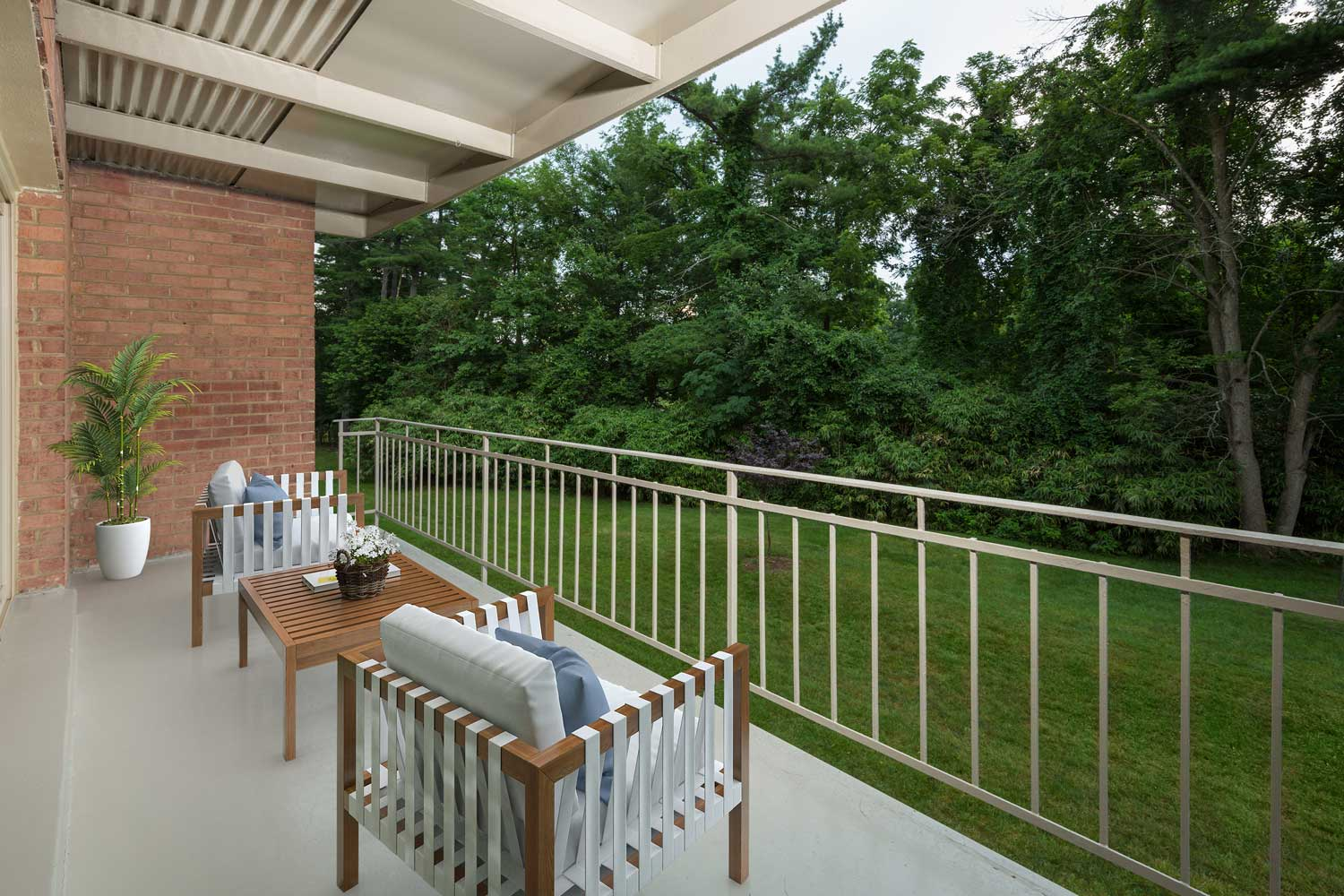 Relaxing, spacious balcony at Village Square West Apartments