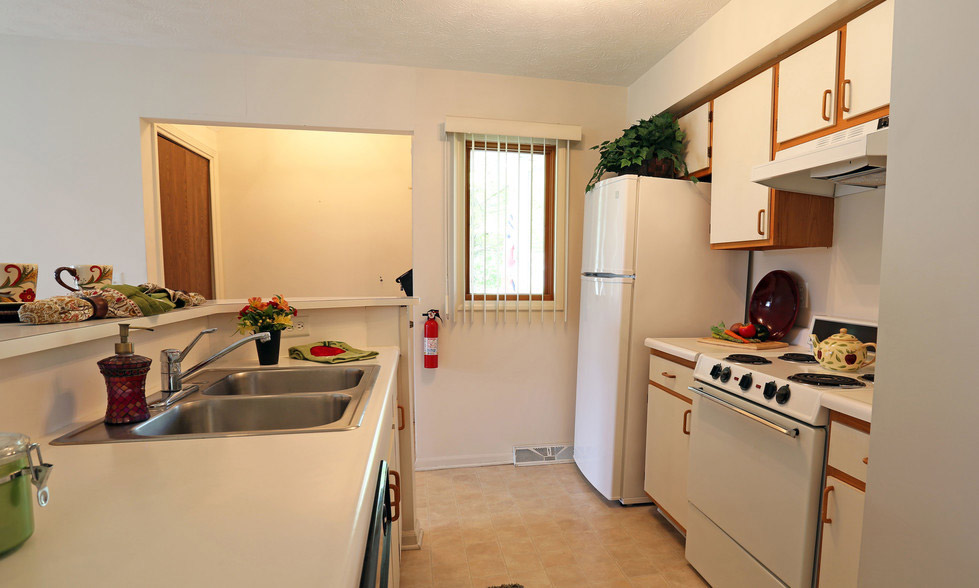White Kitchen Appliances at Village Walk Apartments in Webster, New York