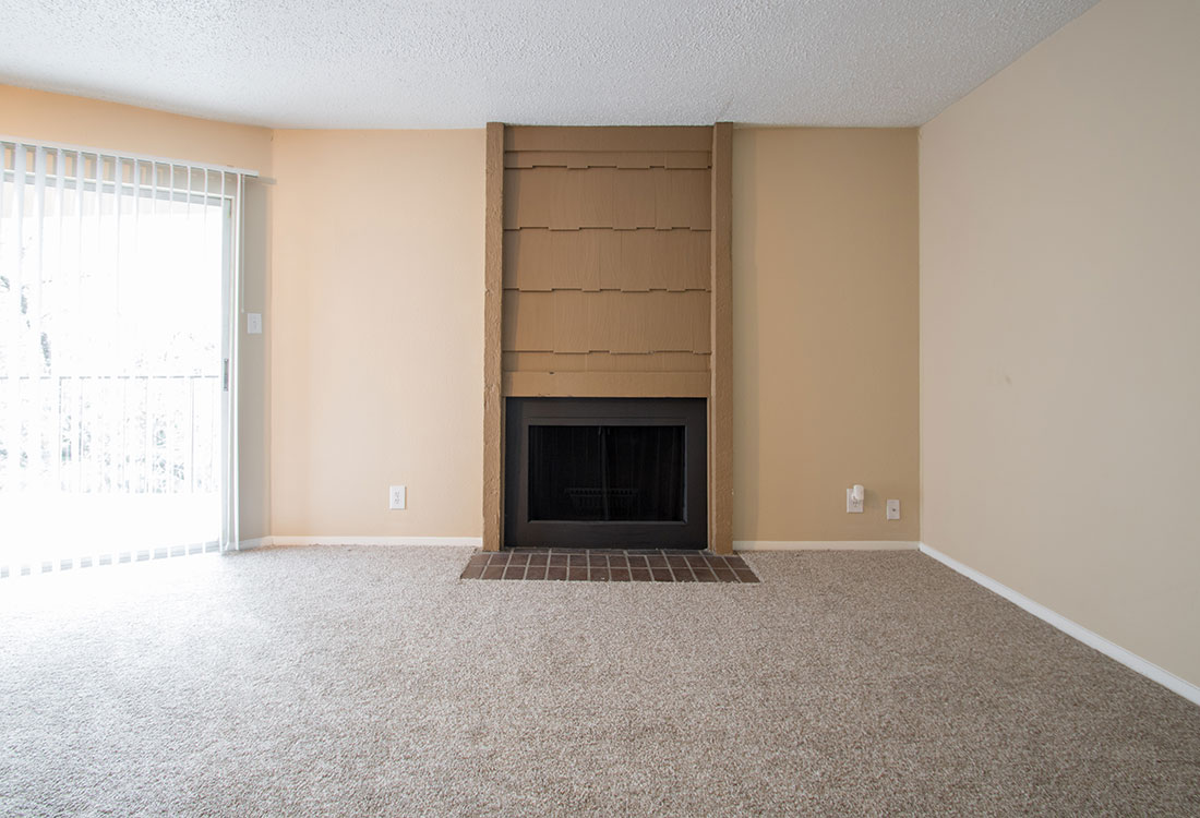 Spacious Living Room with Fireplace at Villas of Oak Creste Apartments in San Antonio, TX