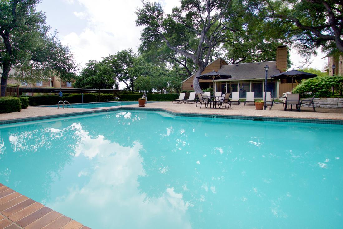 Outdoor Swimming Pool at Villas of Oak Creste Apartments in San Antonio, TX