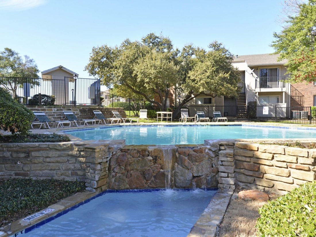 Waterfall and Pool at 6Eleven Lamar Apartments in Arlington, Texas