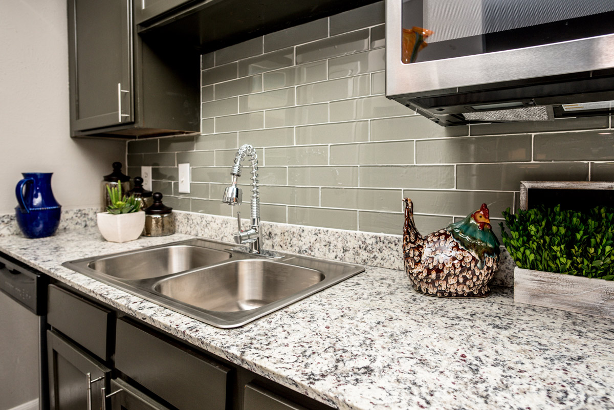 New Kitchens w/ Stainless Steel Appliances at 6Eleven Lamar Apartments in Arlington, TX