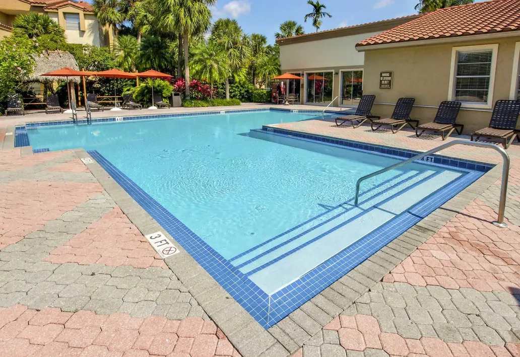 Poolside Seating at Waterford Landing Apartments in Miami, FL
