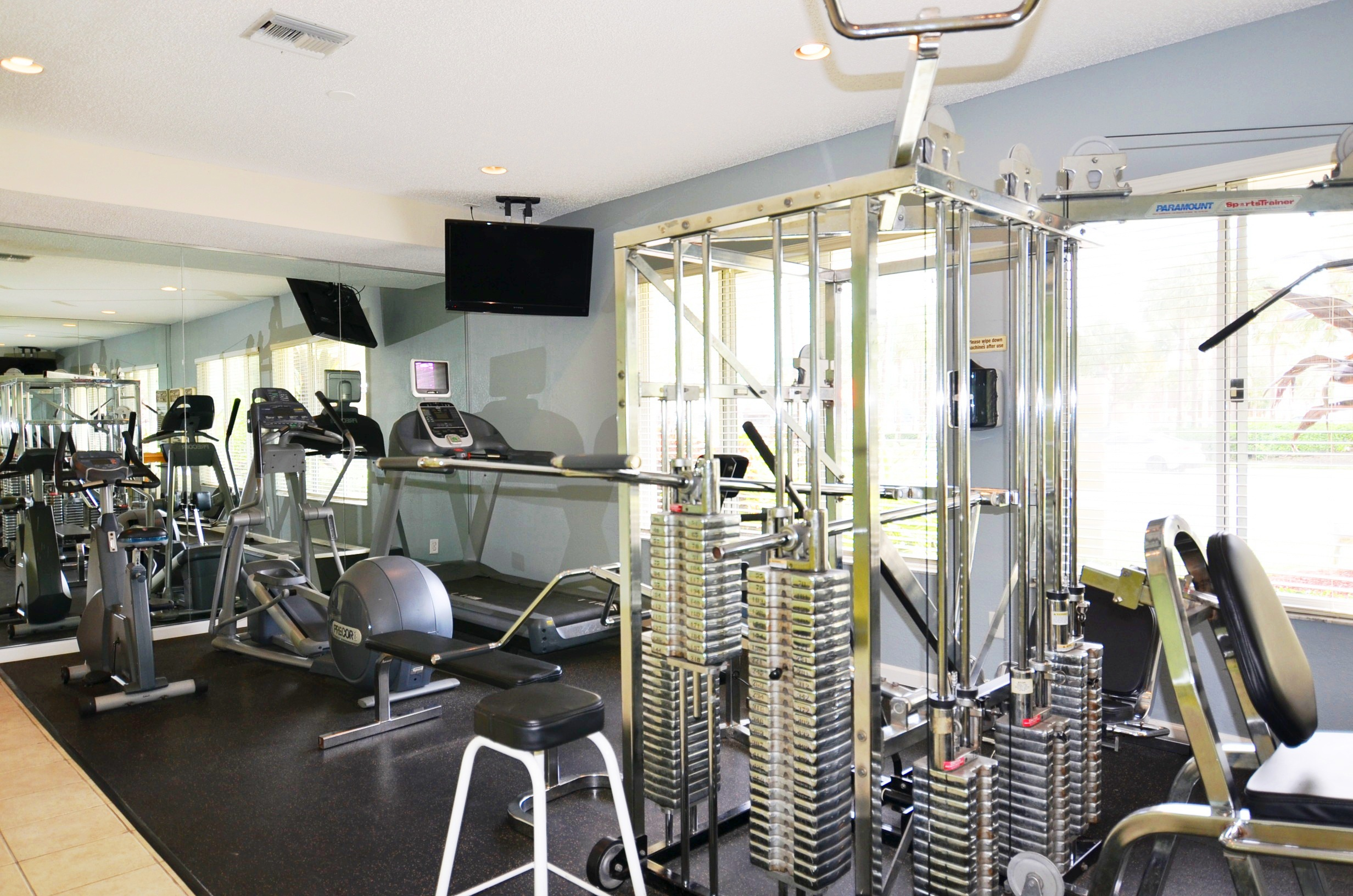 Television and Exercise machines at Waterford Point Apartments in Miami, Florida