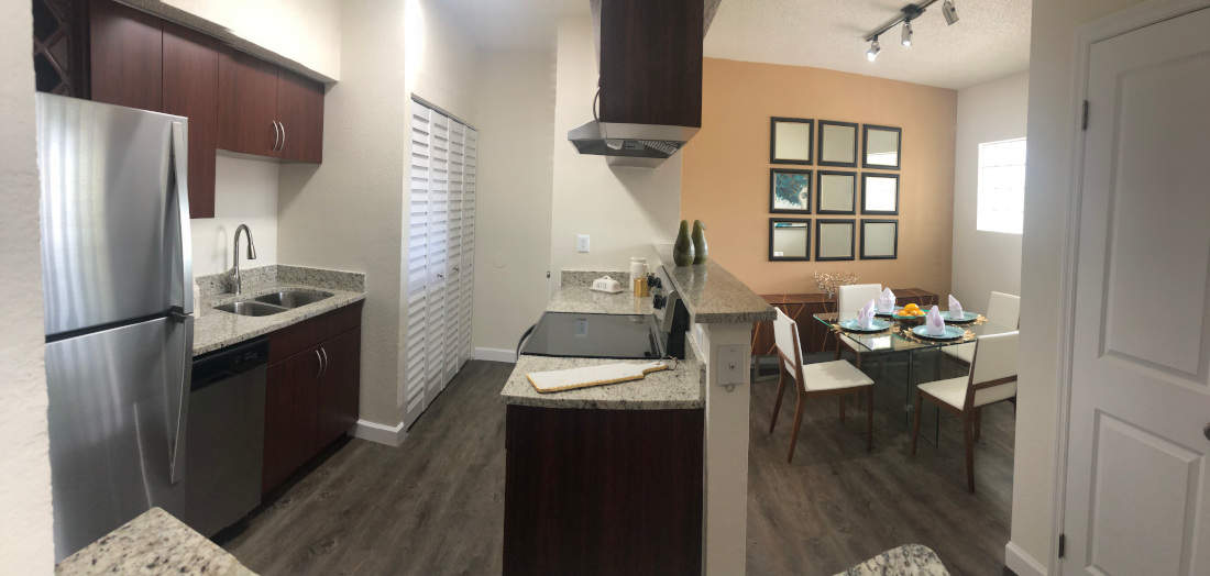Kitchen and dining area at Waterford Point Apartments in Miami, Florida