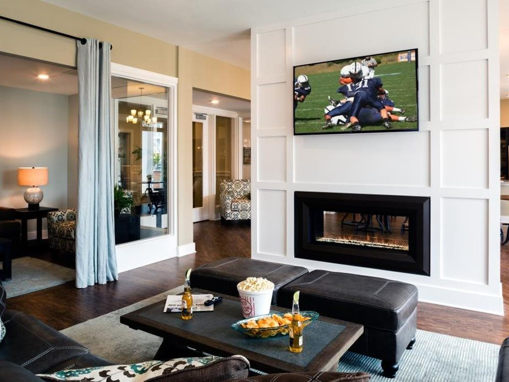 Contemporary Clubhouse with TV and Fireplace at The Watermark Apartments in Norfolk, Virginia