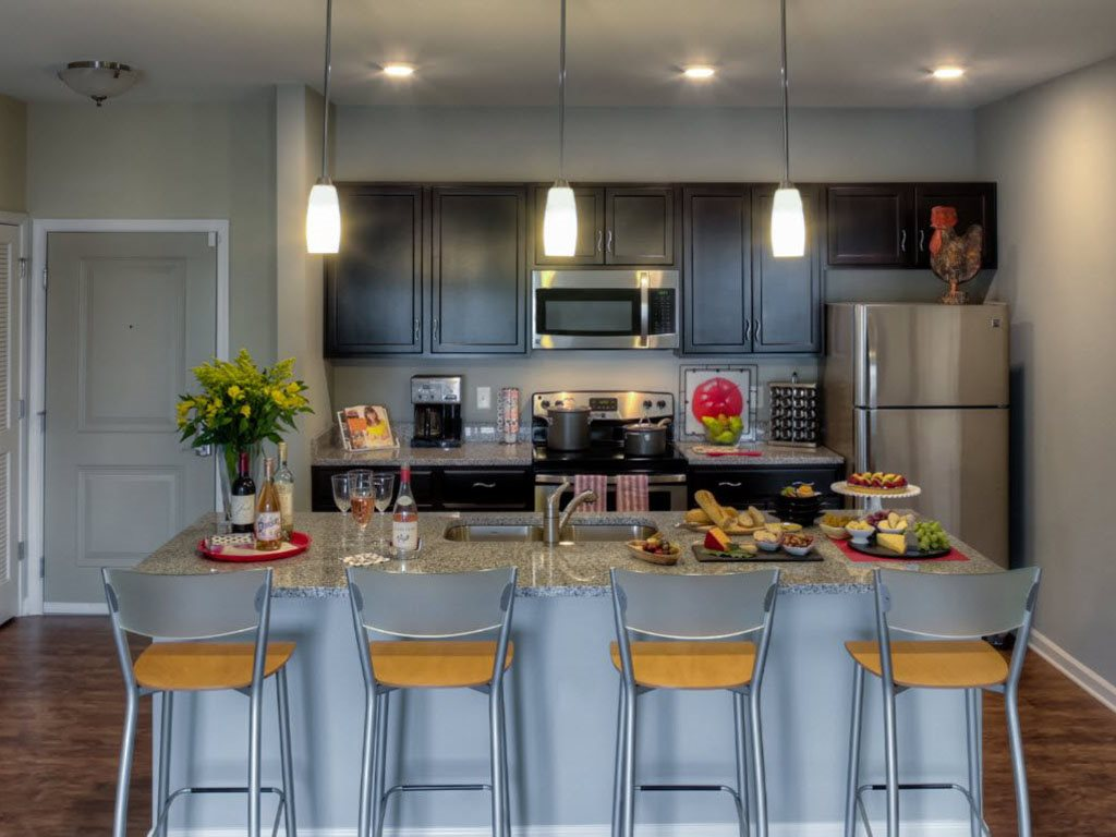 Modern Kitchen with Pendant Lighting at The Watermark Apartments in Norfolk, Virginia