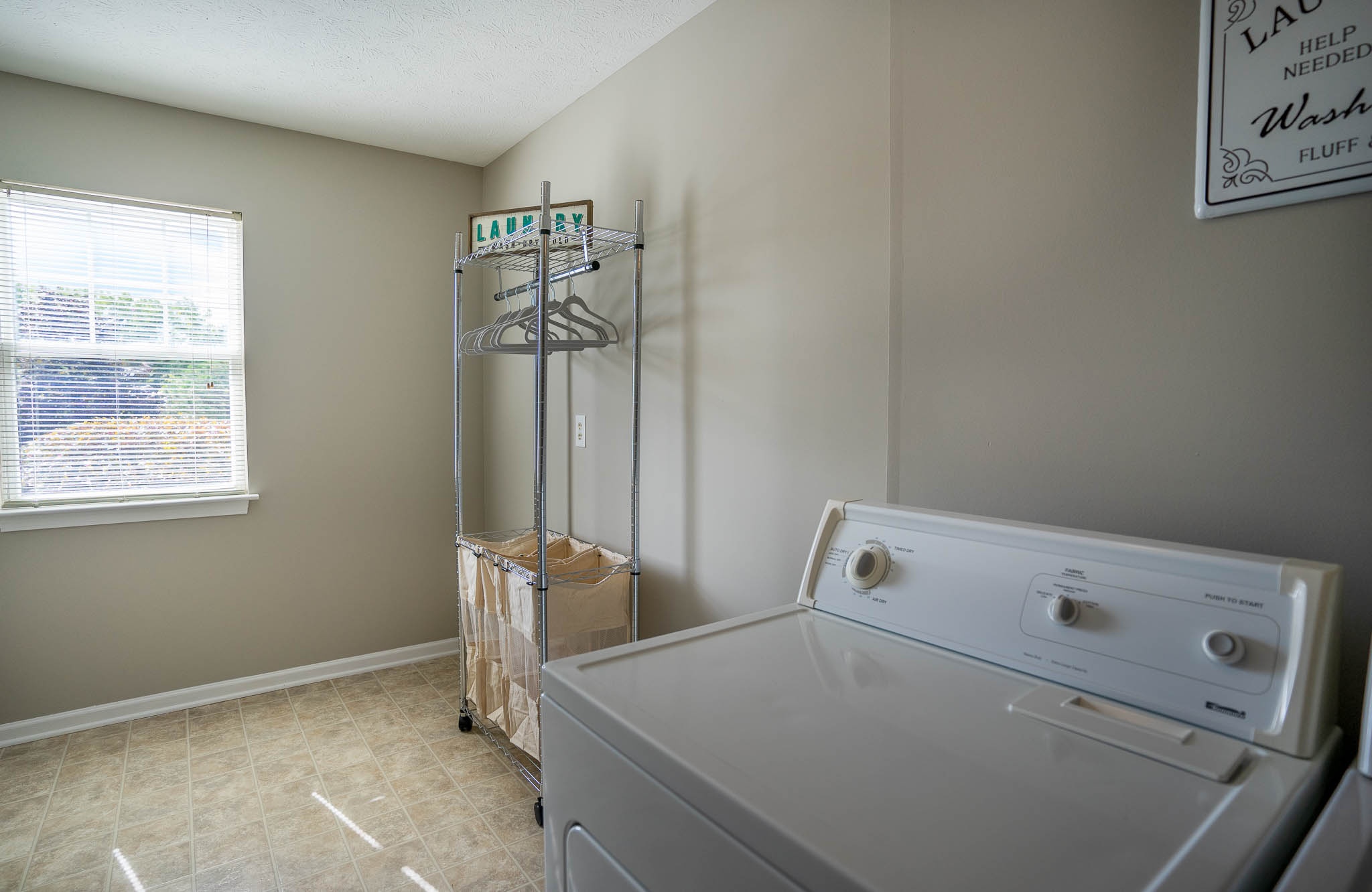 Laundry Room at Webster Woods Townhouse Apartments in Webster, New York
