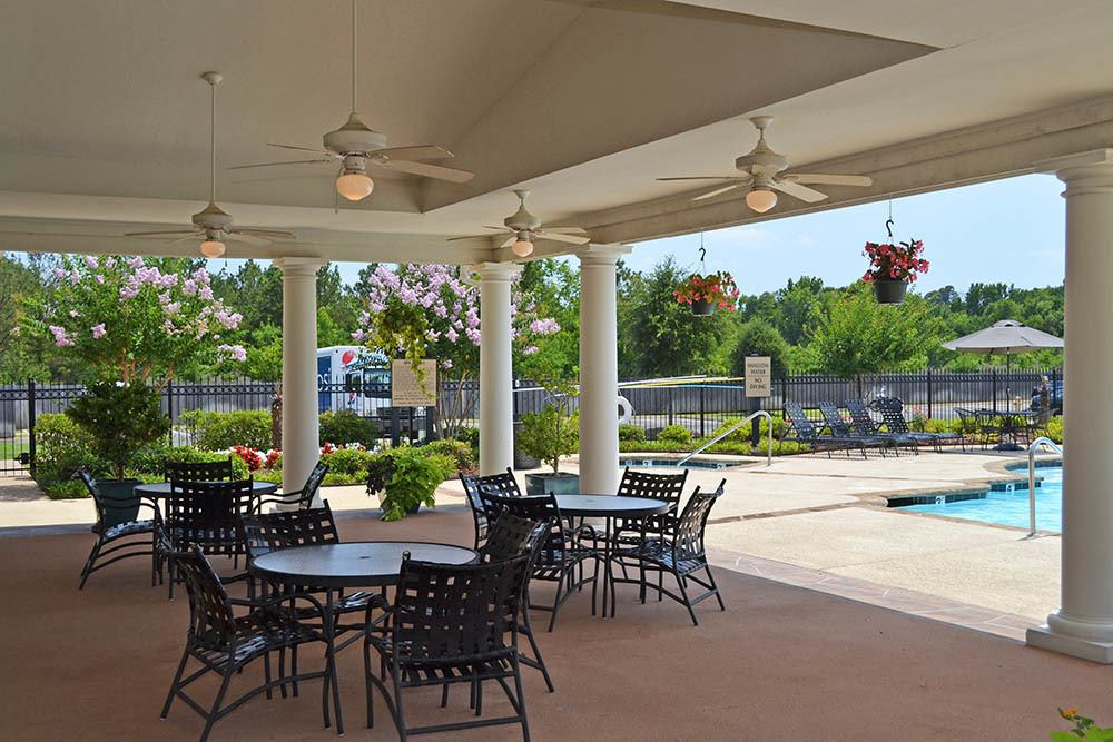 Poolside Seating at Village at Westlake Apartments in Shreveport, Louisiana