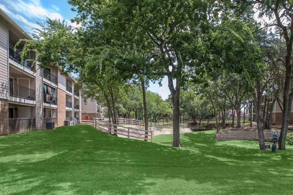 Lush Landscaping at Westmount at Forest Oaks Apartments in Arlington, TX