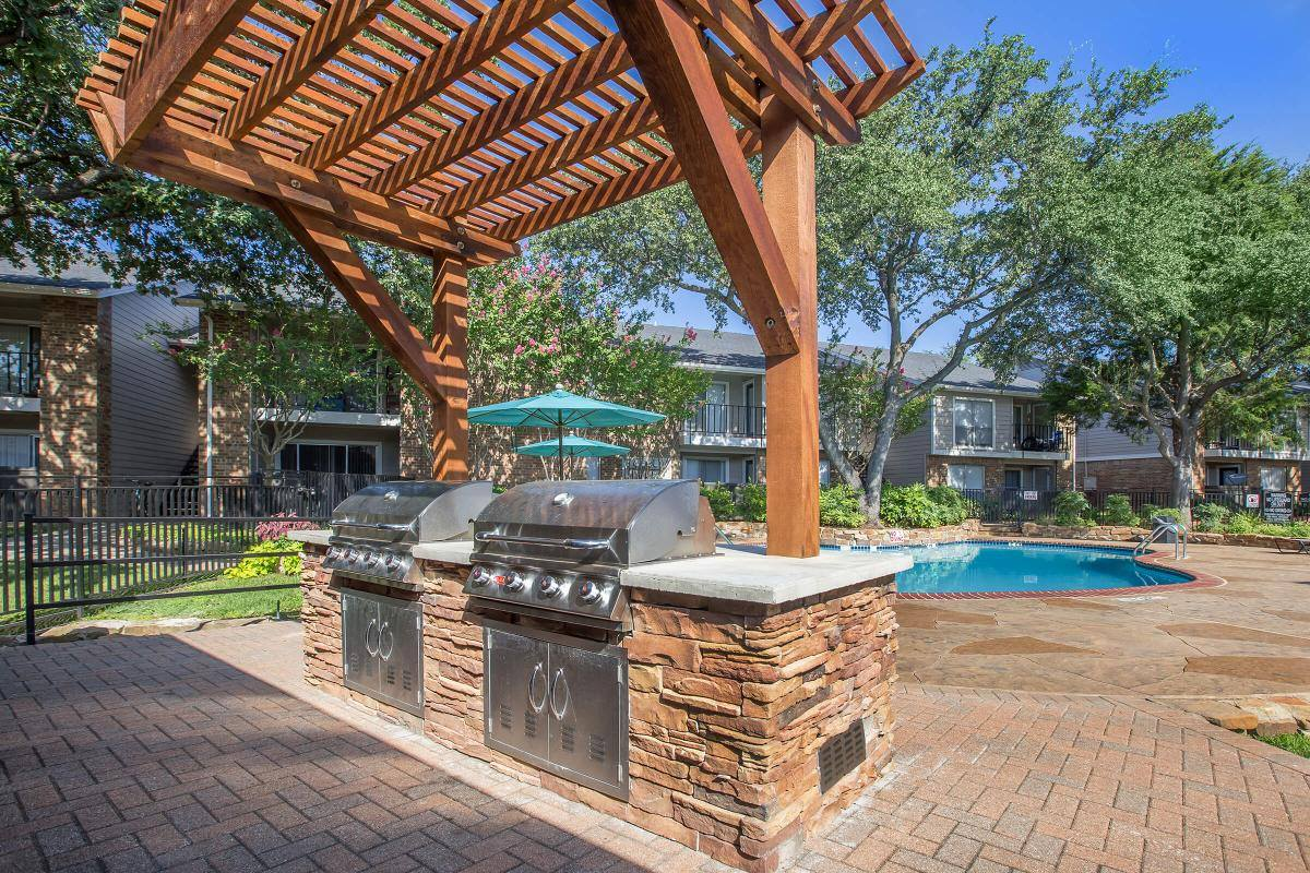 BBQ and Picnic Station at Westmount at Forest Oaks Apartments in Arlington, TX