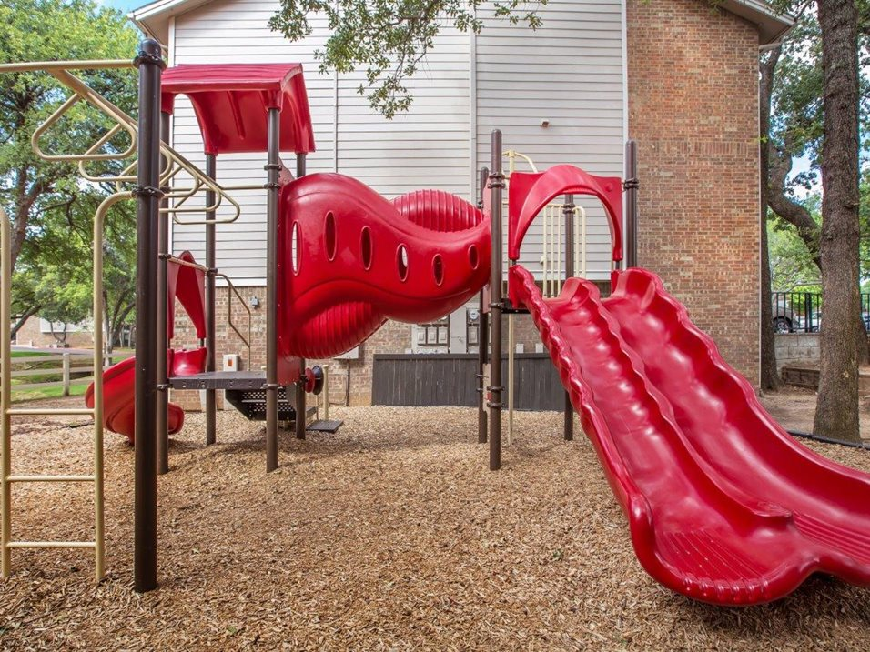 Children's Playground at Westmount at Forest Oaks Apartments in Arlington, TX