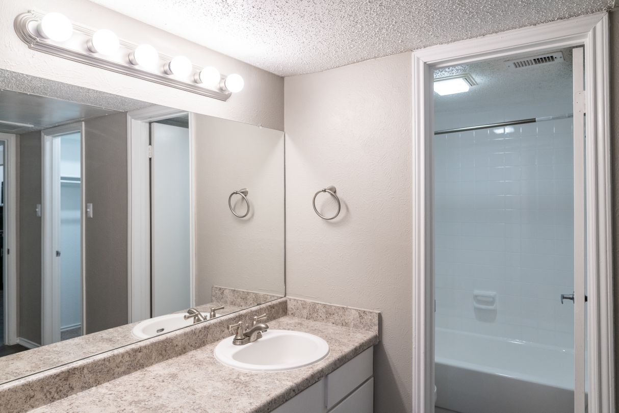Bathroom Vanity with Lighting at Westmount at River Park Apartments in Fort Worth, TX